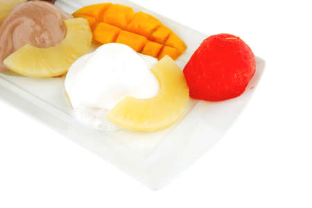 tropical fruits and ice cream on white plate photo