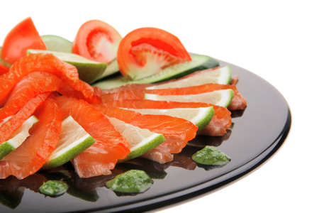 smoked salmon and vegetables served on plate photo
