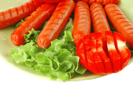 roasted beef sausages over white with salad and ketchup photo