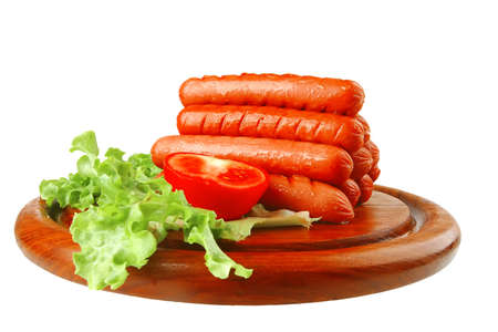 grilled sausages served on wooden plate over white photo