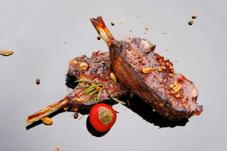 served savory plate: meat ribs with spices and red hot pepper Stock Photo - 14522365