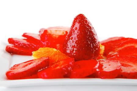 strawberry fruit salad isolated on white plate photo