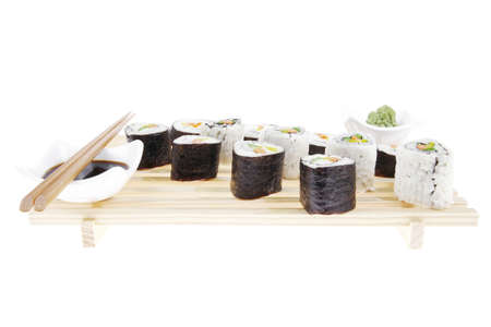Maki Roll with Deep Fried Vegetables inside . on wooden grid . isolated over white background . Japanese Cuisine photo
