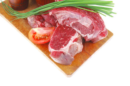 ready to cook: raw beef fillet mignon on cutting board prepared for roasting photo