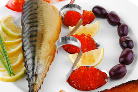 cod fish: red salty caviar with fish on white plate