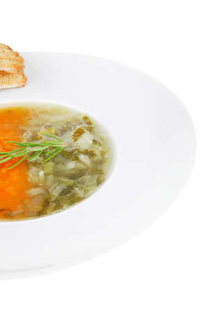 european cuisine: vegetable soup served with toasts on white dish isolated over white photo
