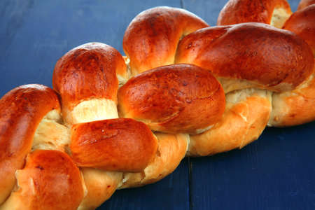 sweet bread : golden challah over blue wooden plate Stock Photo