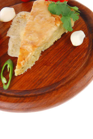 dairy food : cheese casserole triangle served on wood plate with tomatoes, capers, and chives isolated over white background photo
