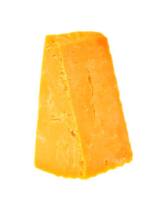 grated cheese: piece of cheddar cheese isolated on a white background