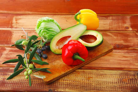 fresh raw vegetables prepared for cutting on wood photo