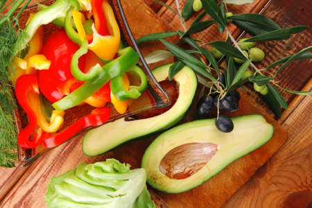 fresh avocado served with peppers on wood photo