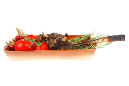 boned: served main course: boned roasted ribs served with raw cherry tomatoes and fresh vegetables