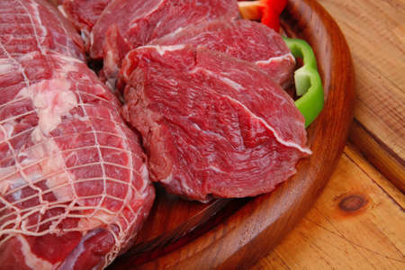 meat ready to cooking over wooden table photo