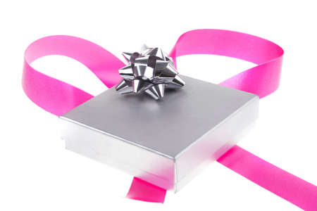 silver gift box with pink bow isolated over white background photo