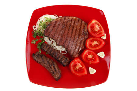 italian food : pasta with tomato and grilled sirloin beef on red plate isolated over white background photo