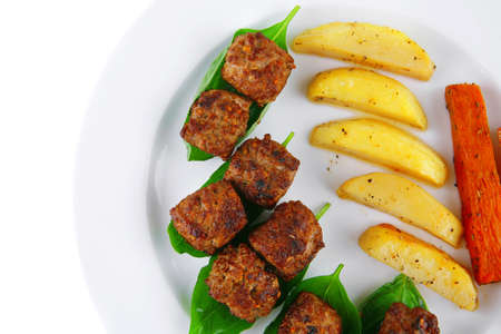 grilled meatballs on white plate with basil and potatoes Stock Photo - 14703152