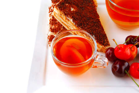 chocolate cakes with tea and cherry photo