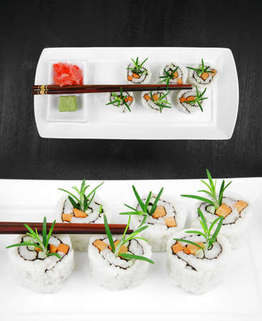 Maki Sushi - California Roll made of Smoked salmon, Cream Cheese and Deep Fried Vegetables inside.  Stock Photo - 14741143