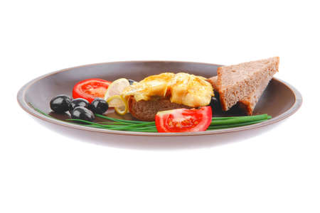 served roast golden fish fillet with tomatoes, rye bread and olives Stock Photo - 14783002