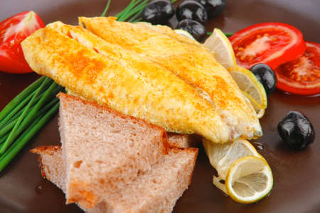served roast golden fish fillet with tomatoes, rye bread and olives Stock Photo - 14786318