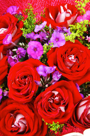 flowers : big bouquet of rose and pansy flowers with green grass in red wrapping papper Stock Photo - 14787123