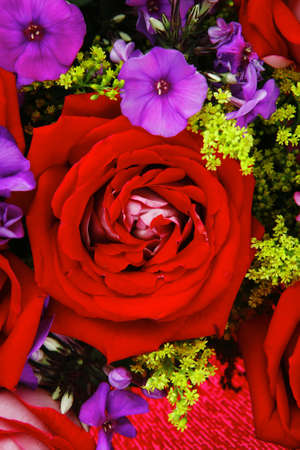 flowers : big bouquet of rose and pansy flowers with green grass in red wrapping papper Stock Photo - 14788879