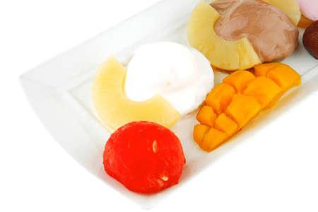 ice cream on pineapple with mango on plate photo