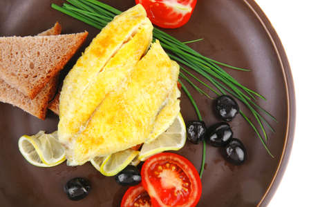 grilled fish fillet served with tomatoes,olives and bread Stock Photo - 14787433