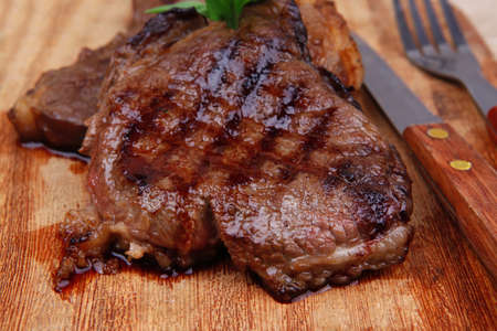 served beef meat barbecue on wooden plate with cutlery Stock Photo - 14783115