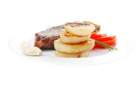 meat savory : grilled beef fillet served on white plate with tomatoes and potatoes isolated over white background photo
