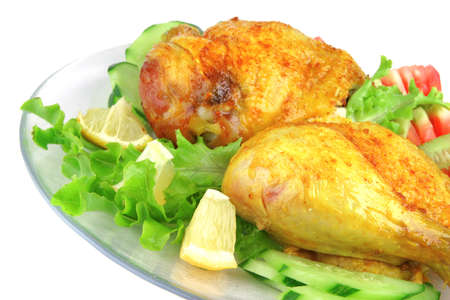 gold grilled chicken leg served with vegetables photo