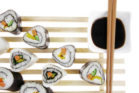 Roll with Cucumber , Cream Cheese with raw Tuna and Salmon inside. on wooden grid . Isolated over white background . Japanese traditional Cuisine photo