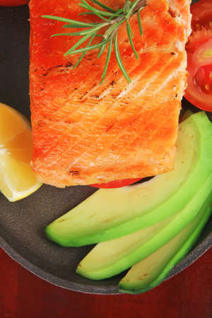 food: hot grilled salmon on metal pan over wooden plate isolated on white background Stock Photo - 14945592