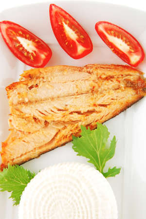 grilled pink salmon fillet with soft cheese on white photo