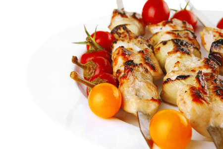 fresh roast pork shish kebab on white platter