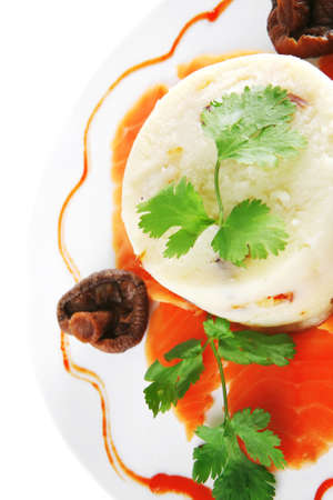 pink smoked salmon with mashed potatoes served on white photo