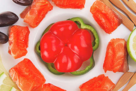 fresh smoked salmon slices on white with olives photo