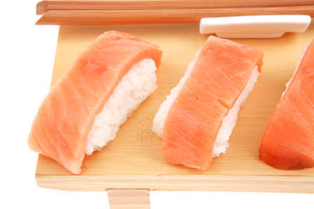 Nigiri Sushi - Set of Nigiri sushi topped with raw Salmon . isolated over white background . on wooden board photo