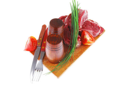 pepper castor: ready to cook: raw beef fillet mignon on cutting board prepared for roasting Stock Photo