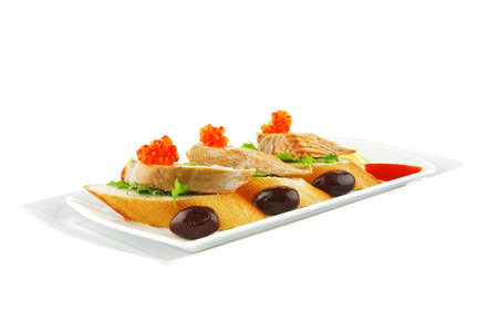 small salmon sandwiches served with caviar and olives Stock Photo