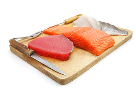 fresh raw sole , salmon , and red tuna fish  pieces on wooden plate isolated on white background