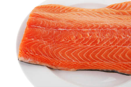 raw big salmon bar on white plate photo