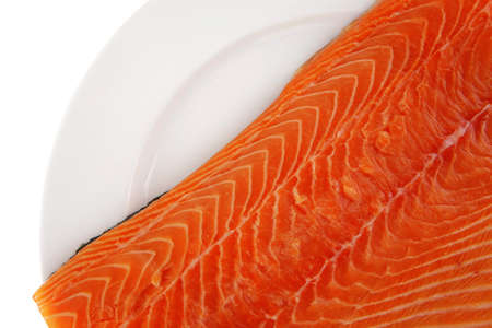 fresh raw red fish fillet on white plate photo