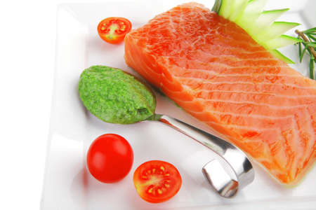 smoked salmon bar on plate with tomatoes and pesto sauce Stock Photo - 15012473