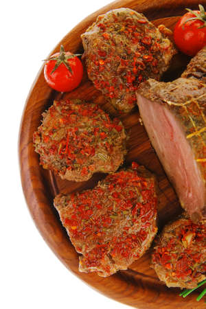 meat chops with green chives on wooden plate photo
