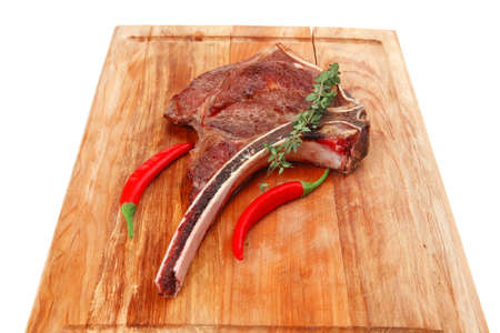meat food : grilled beef spare rib on wooden plate with thyme isolated over white background photo