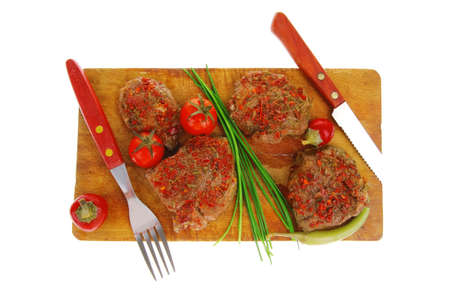 spicy meat on wood with pepper and chives photo