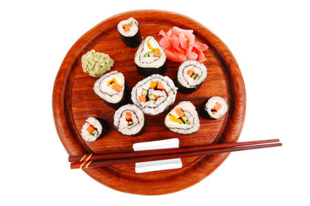 sake maki: Maki Sushi : Maki Rolls and California rolls made of fresh raw Salmon(sake), Tuna(maguro) and Eel(unagi) . on wooden plate with wasabi and ginger isolated over white background