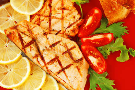 grilled pink salmon with lemon and toasts photo