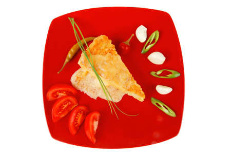 meatless: food : vegetable casserole piece over red plate ready to eat with chives tomatoes peppers and chives isolated over white